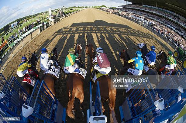 Belmont Stakes Fisheye view from rear of Victor Espinoza in action out of starting gates aboard American Pharoah during race at Belmont Park American...
