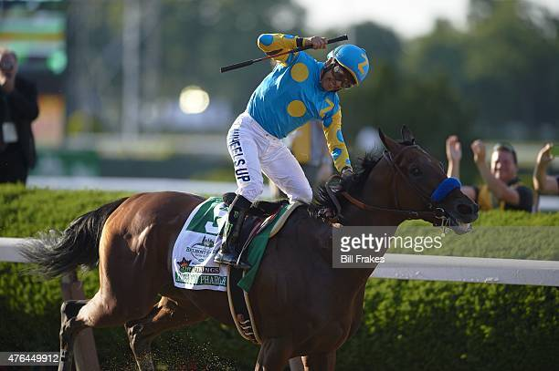 Belmont Stakes Victor Espinoza in action and victorious after crossing finish line to win race aboard American Pharoah at Belmont Park American...