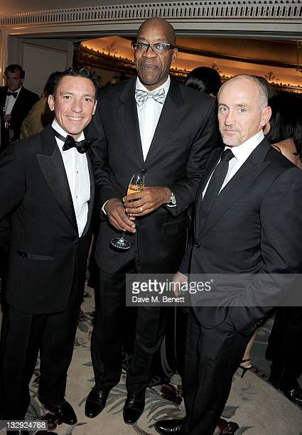 Horse racing jockey Frankie Dettori former track and field athlete Ed Moses and former boxer Barry McGuigan attend the Cartier Racing Awards 2011 at...