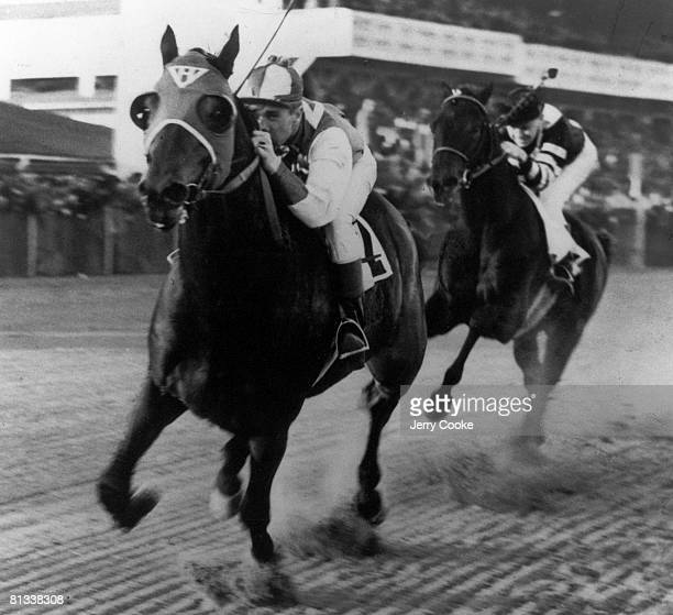 Horse Racing Match Race George Woolf in action winning race aboard Sea Biscuit vs Charles Kurtsinger in action aboard War Admiral at Pimlico Race...