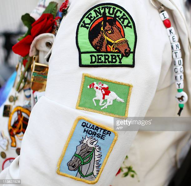 Horse racing patches are seen on the sleeves of Charles 'Derbyman' Matasich of Proctorville Ohio at Churchill Downs in Louisville Kentucky on the...