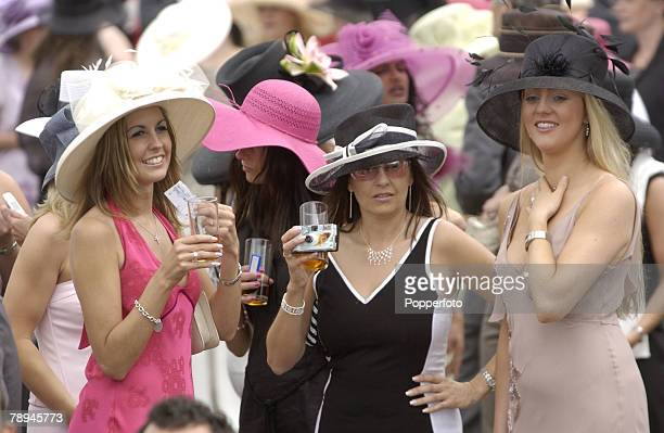 Horse Racing Royal Ascot Ascot England 19th June 2003 Three lady spectators wearing large hats enjoy a drink while waiting for the next race