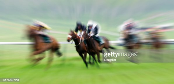 Horse Racing with Blur in the Race Horse and Jockies