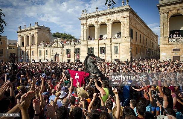 A horse rears in a crowd during the traditional San Juan festival in the town of Ciutadella on the Balearic Island of Menorca on the eve of Saint...