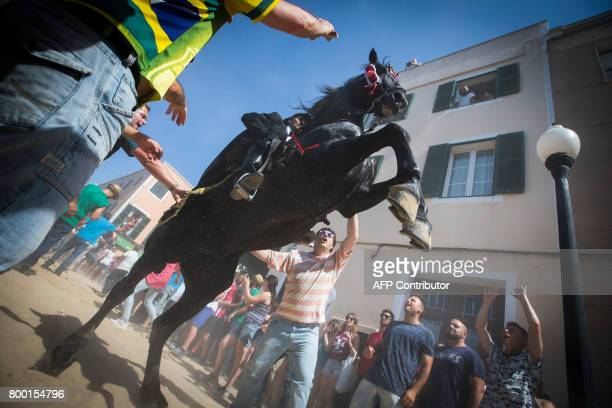 A horse rears in the crowd during the traditional San Juan festival in the town of Ciutadella on the Balearic Island of Menorca on the eve of Saint...