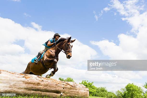 Horse rider jumping on horse