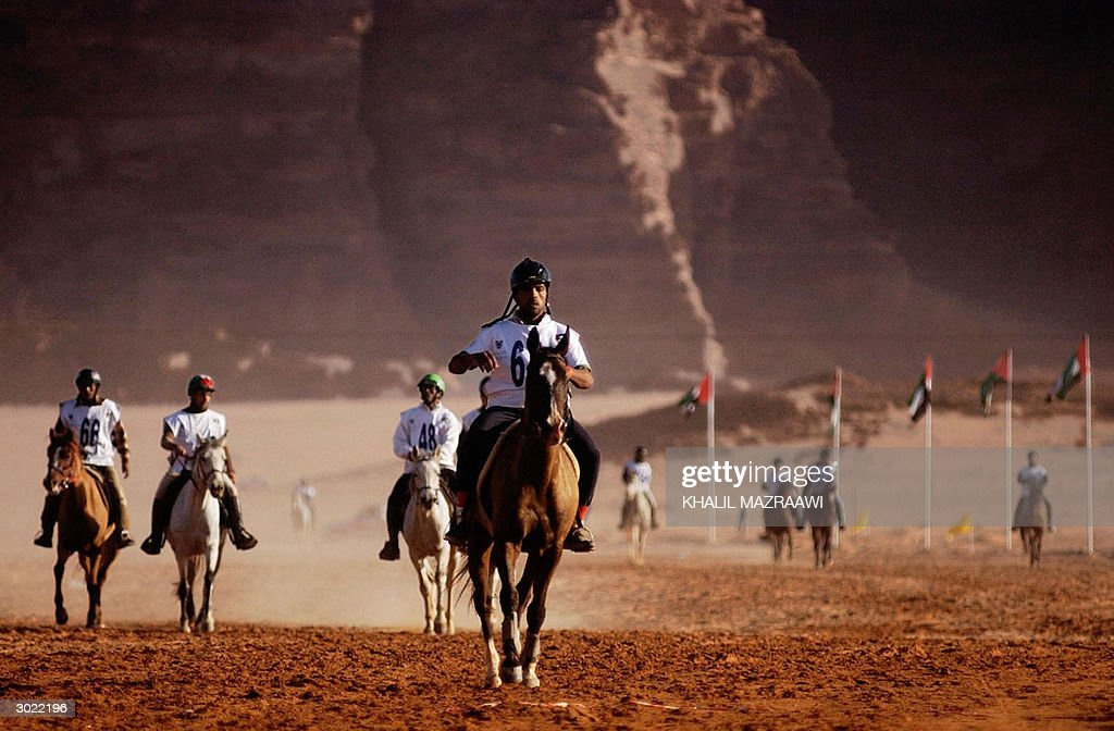 Horse riders from Arab and foreign countries participate in the 120 kms Wadi Rumm horse Endurance Race in southern Jordan 28 February 2004 AFP...