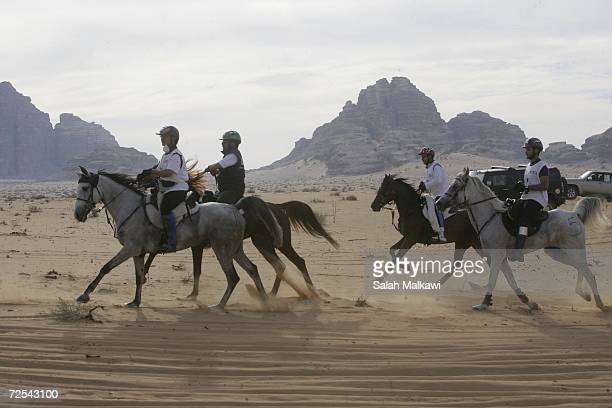Horse riders from the Middle East compete in a 120 km International Endurance Race November 14 2006 in the desert of Wadi Rum in southern Jordan