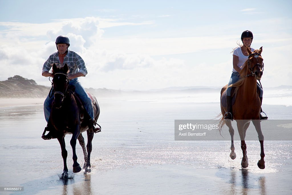 Horse riders galloping, Pakiri Beach, Auckland, New Zealand