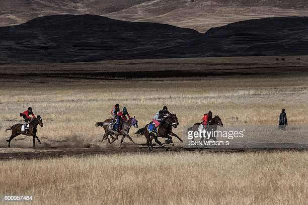 Horse riders race through the fields on July 16 2016 in Semonkong Horseracing in the mountain kingdom of Lesotho is not like at Ascot or Longchamp...