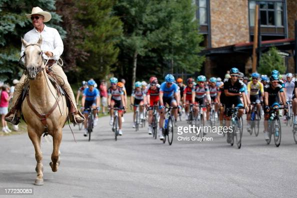 A horse rides in front of the peloton during stage four of the 2013 USA Pro Cycling Challenge from Steamboat Springs to Beaver Creek on August 22...