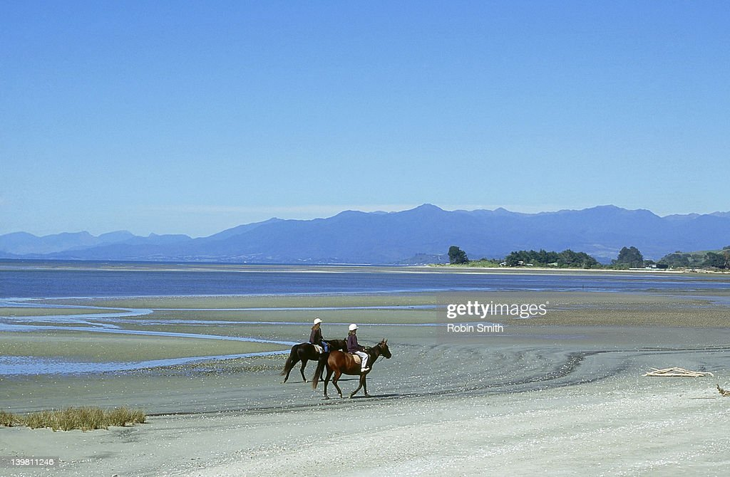 Horse Riding on Golden Bay, Nelson Province, South Island, New Zealand : Stock Photo