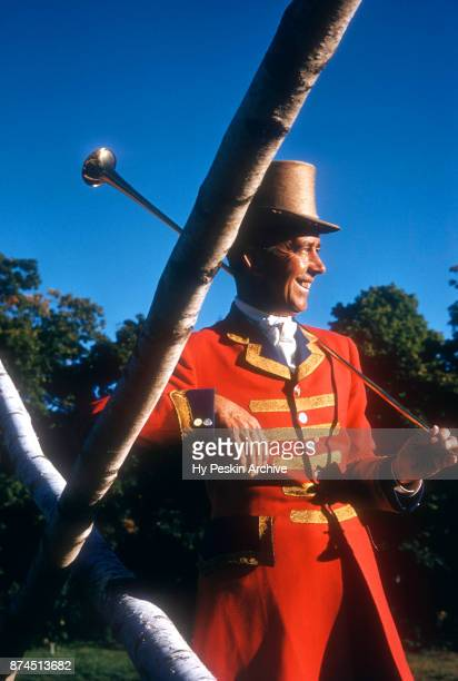 Horse Show Ringmaster Clarence L Craven wearing a jacket stlyled after the English guardsman's coat and holding a coach horn on September 21 1955 in...