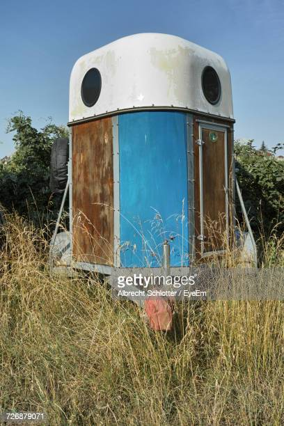Horse Trailer On Grassy Field Against Clear Sky
