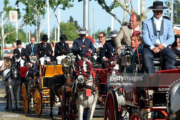 Horseback parades through the fairground at the 'Feria de Abril 2015' the traditional Seville's Fair on April 21 2015 Women wearing the traditional...