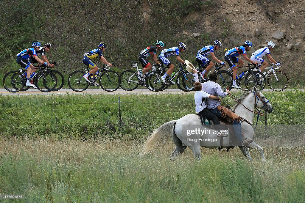 A horseback rider chases the breakaway during stage six of the 2013 USA Pro Challenge from Loveland to Fort Collins on August 24, 2013 in Estes Park, Colorado.
