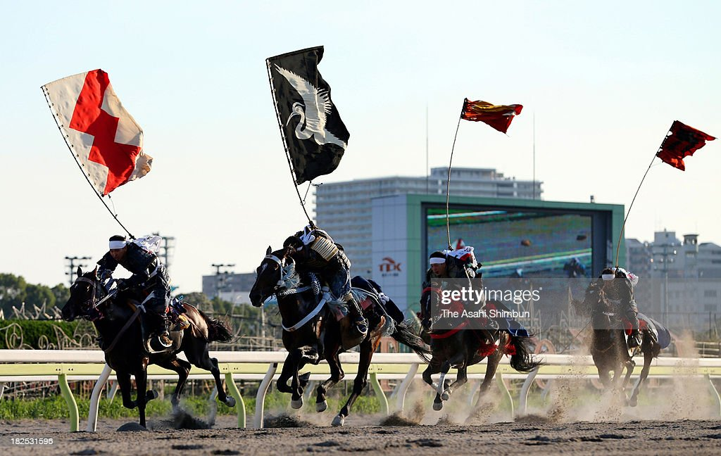 Horseback riders clad in samurai armor race through the course during the Soma Nomaoi festival at the Tokyo City Keiba racecourse on September 29, 2013 in Tokyo, Japan. The Soma Nomaoi festival is a local event held annually in Fukushima's Soma area, heavily hit by the March 2011 Great East Japan Earthquake and tsunami, and subsequent nuclear disaster.