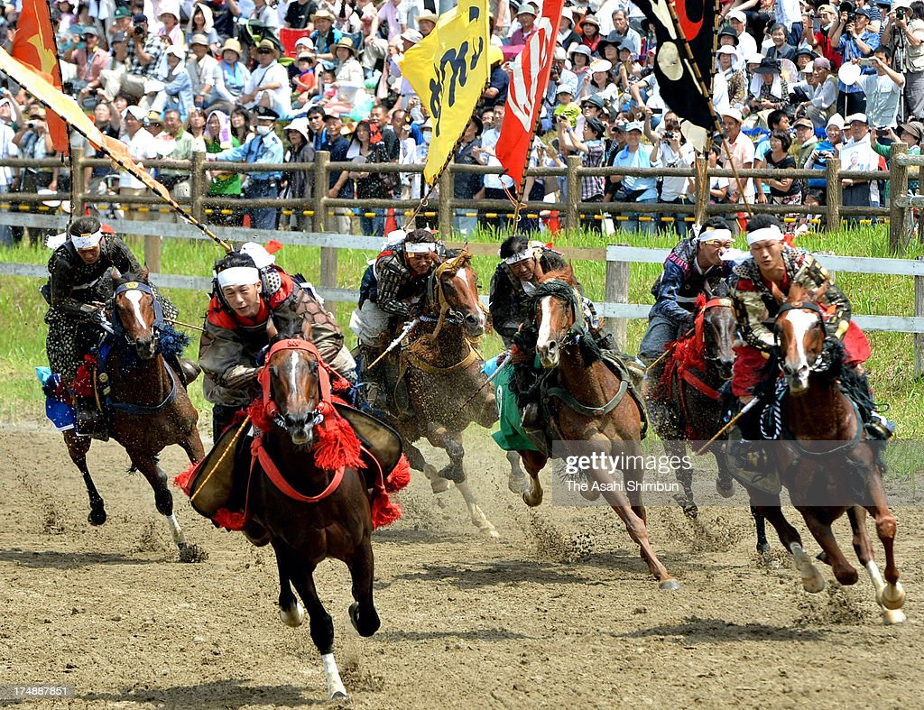 Horseback riders in full-body armor compete during the 'Soma Nomaoi Festival' on July 23, 2012 in Minamisoma, Fukushima, Japan. Some 350 riders participate in this year's festival, attract 45,000 visitors.