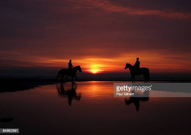 Horseback riders patrol the beach at sunset ahead of the Enduropale race featuring over 1000 motorbikes in The 4th Enduropale du Touquet 2009 at Le...