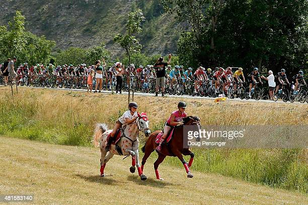 Horseback rides pace the peloton during stage 17 of the 2015 Tour de France from DigneLesBains to Pra Loup on July 22 2015 in Allos France