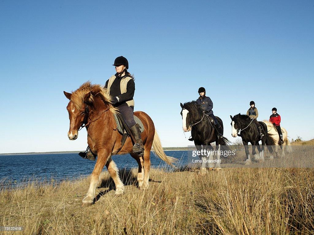 Horseback riding by the sea.