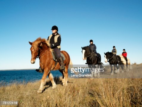Horseback riding by the sea.