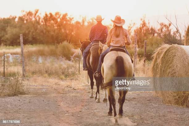 A Horseback Riding Couple in the Utah Country with Golden Light