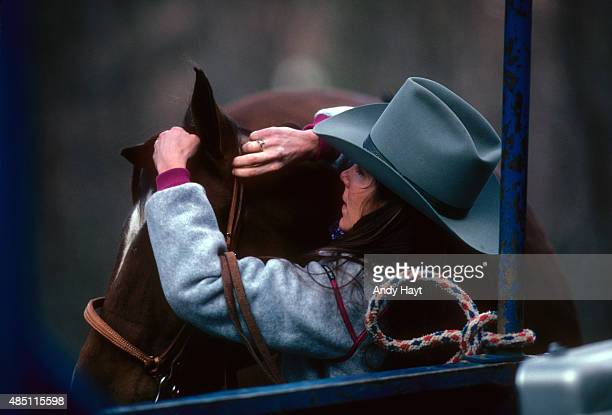 Sporting Look Portrait of Connie Blake places a halter on SurSox while wearing fleece jacket from Roffe during photo shoot at Taos Ski Valley Taos...