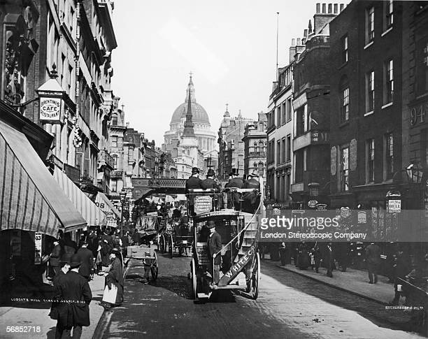 A bus makes its way down Fleet Street towards Ludgate Hill Circus and St Paul's Cathedral London circa 1888