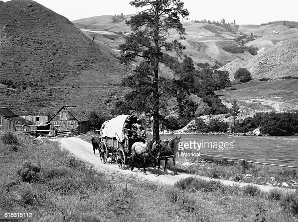 Horsedrawn covered wagon on trail in Idaho