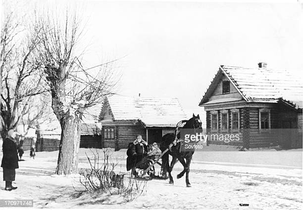 A horsedrawn sled in a russian village 1930s