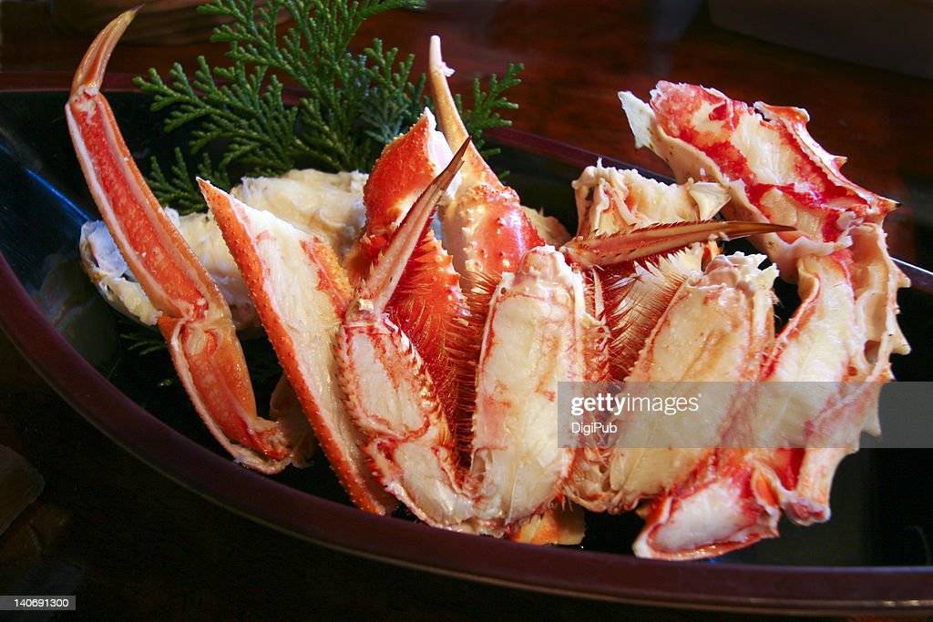 Horsehair crab served in boat shaped wooden tray : Stock Photo