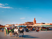 A horseman driving a carriage in the Djemaa El Fna square the most wellknown place in Marrakesh and Morocco Here many people gather together everyday...