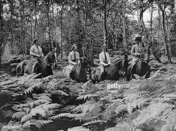 Horsemen ride across a glade with bracken and silver birches just off the Epping Loughton road near Lougthon 2nd August 1937 Photograph