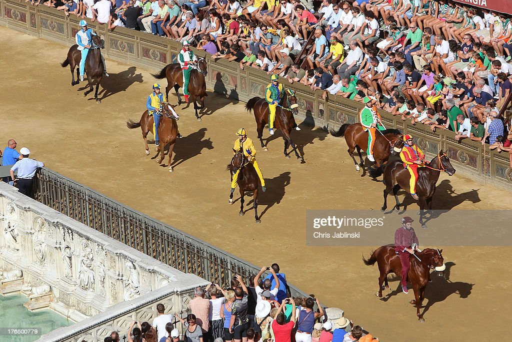Horsemen ride in the second rehearsal for the Palio also called Prova on August 13, 2013 in Siena, Italy. The so-called Tratta, in which the ten horses are allocated to the varying city districts or contrada is a precursor to the Palio di Siena, a twice annual summer event, in which riders representing city districts compete, in a tradition that dates back to 1656.