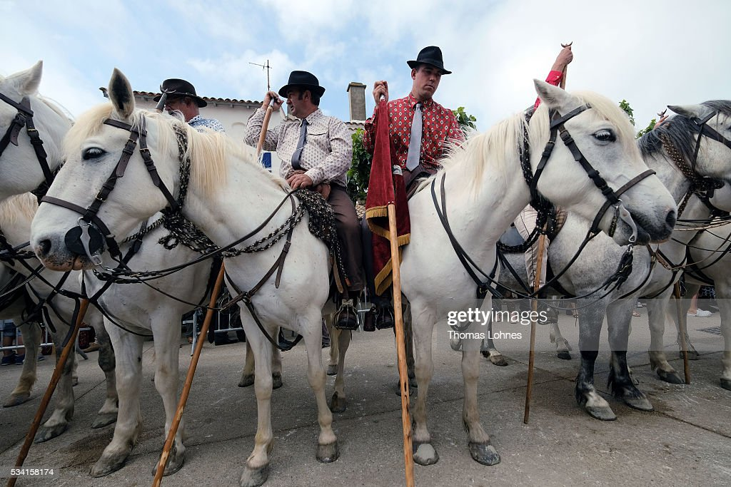 Horsemen wait in front of the church for the beginning of the procession of gypsies and local members with the sculpture ot Virgin Mary to the sea on May 25, 2016 in Saintes-Maries-de-la-Mer near Arles, France. Gypsies from all over Europe worship 'Sara the Black', their Saint and patroness, for one week. Sara's statue is situated in the crypt of the church.