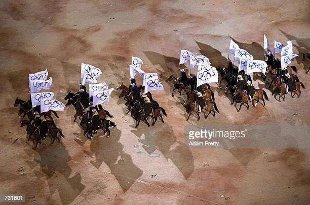Horseriders carry Olympic flags during the opening ceremony of the Sydney 2000 Olympic Games September 15 2000 in the Olympic Stadium in Sydney...