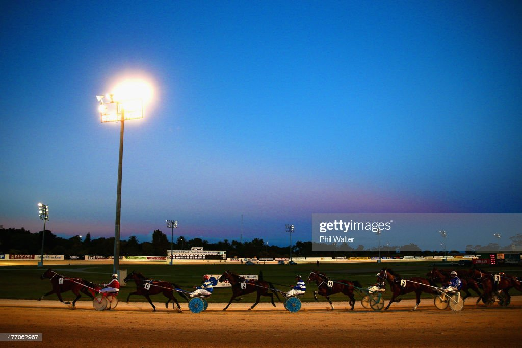 Horses and drivers finish the Jacobsen Headstones Handicap Trot during the 2014 Auckland Trotting Cup at Alexandra Park on March 7, 2014 in Auckland, New Zealand.