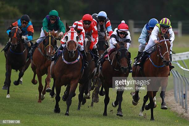 Horses and jockey's gallop around the bend as they head into the finish straight during a day at the Races at the Gore Race Meeting Gore Southland...