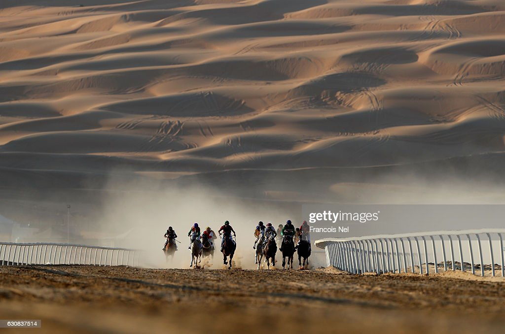 Horses and jockeys in action during the Liwa Sports Festival at Moreeb Dune on January 3, 2017 in Abu Dhabi, United Arab Emirates.