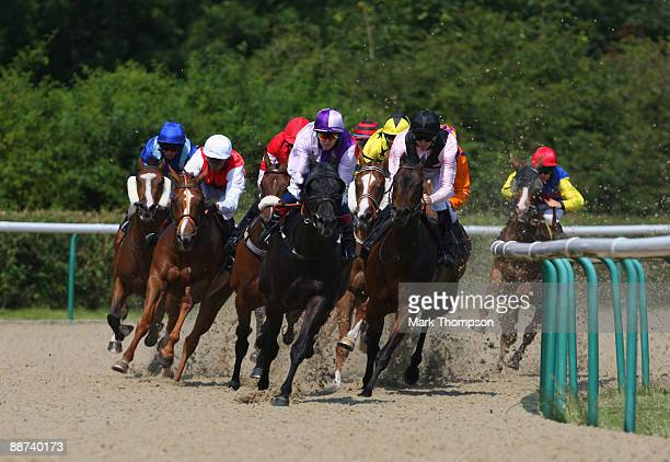 Horses and riders round the first bend in the Carlsberg Export Selling Stakes race at Dunstall Park on on June 29 2009 in Wolverhampton England