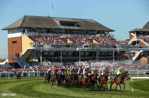 Horses and riders take a bend during the Gaskells Handicap Hurdle Race at Aintree Racecourse on April 8 2017 in Liverpool England