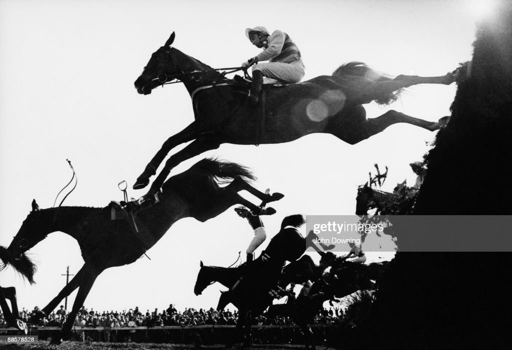 Horses and riders take the Becher's Brook fence during the Grand National at Aintree, Liverpool, April 1983.