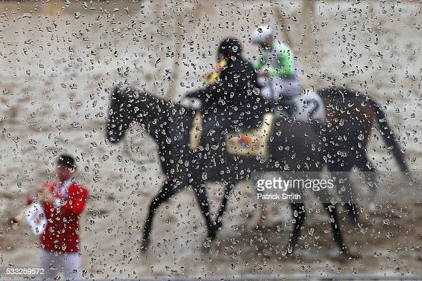 Horses are paraded before a race prior to the 141st running of the Preakness Stakes at Pimlico Race Course on May 21 2016 in Baltimore Maryland