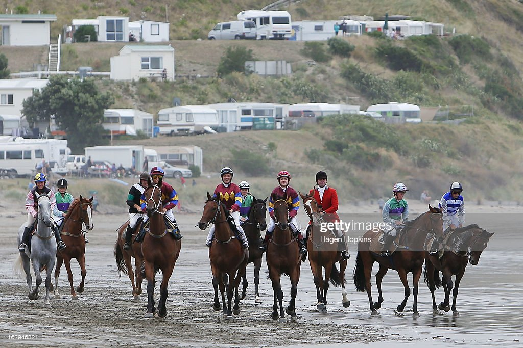 Horses arrive on the beach for the Tinui Highweight Handicap Open during the Castlepoint Beach Races at Castlepoint Beach on March 2, 2013 in Masterton, New Zealand.