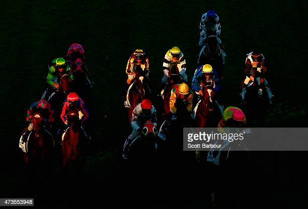 Horses bunch together as they race through a shaft of light in race 9 the Charter KC BSP Lawyers Plate during Taralye Race Day at Caulfield...