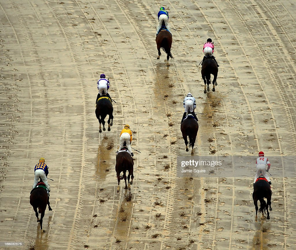 Horses competing in race #9 pull up on a sloppy track after crossing the finish line on Kentucky Derby day at Churchill Downs on May 4, 2013 in Louisville, Kentucky.