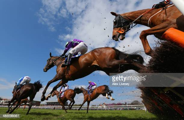 Horses jump a fence during The £3 Million totescoop6 Today Handicap Hurdle Race at Haydock Racecourse on April 19 2014 in Haydock England