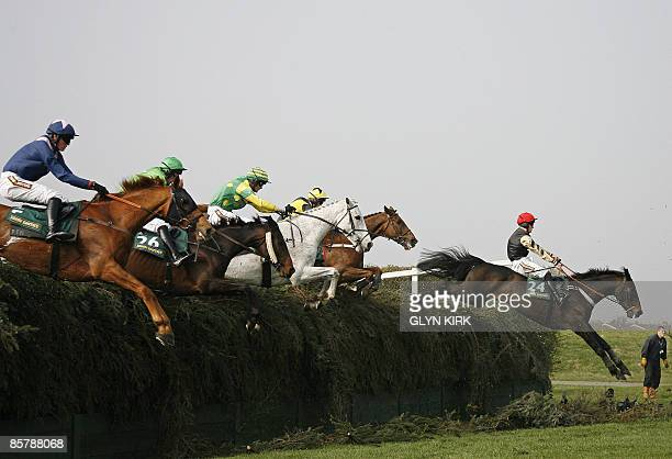 Horses jump Bechers Brook during The Topham Steeple Chase on the second day of the Grand National meeting at Aintree Racecourse in Liverpool...