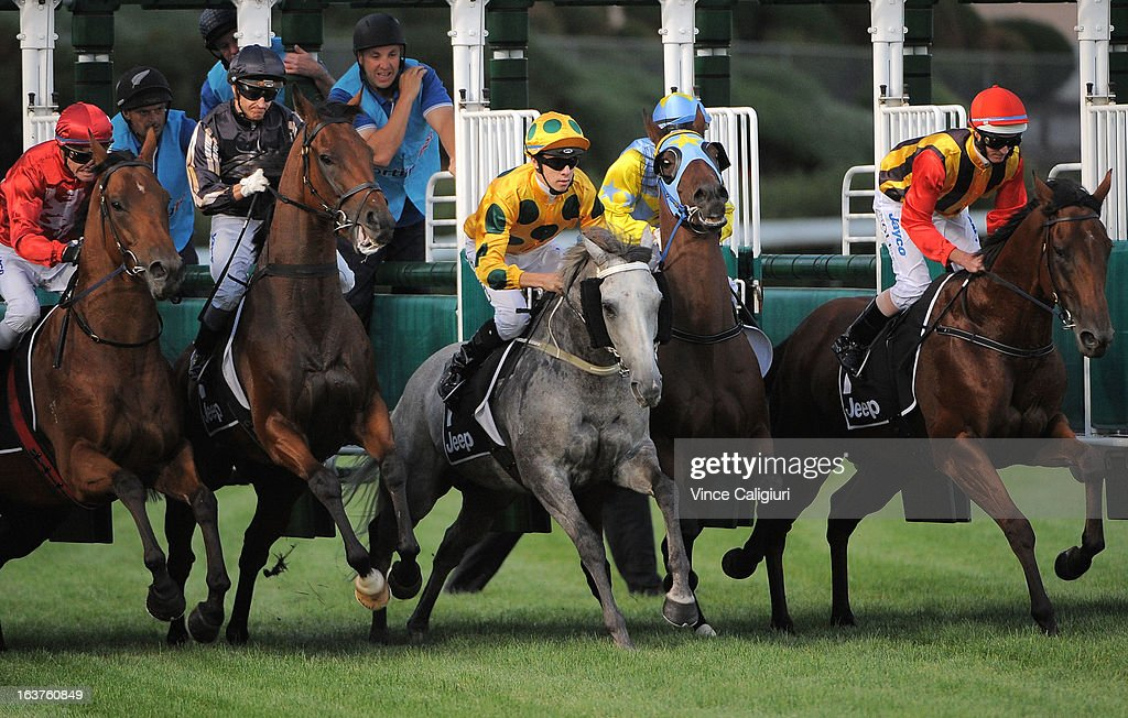 Horses jump out of the barriers in the 1Print.com.au Handicap with <a gi-track='captionPersonalityLinkClicked' href=/galleries/search?phrase=Luke+Nolen&family=editorial&specificpeople=2190756 ng-click='$event.stopPropagation()'>Luke Nolen</a> riding Fresh Light going on to win during Melbourne racing at Moonee Valley Racecourse on March 15, 2013 in Melbourne, Australia.